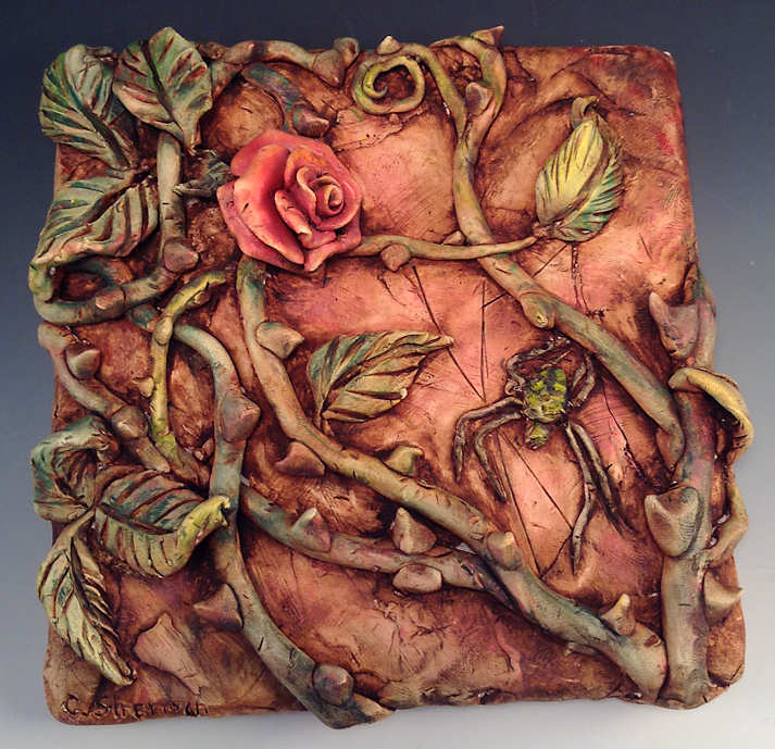 Rose and spider relief sculpture on ceramic tile painted for Clay mural making