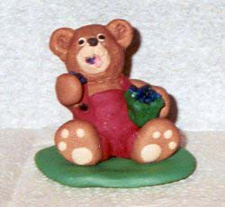 polymer clay bear eating blueberries