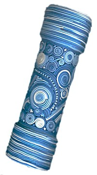 polymer clay kaleidoscope with shades of blue and white balinese filigree